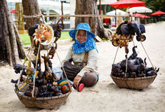 The woman the seller souvenirs on a beach in Thailand Royalty Free Stock Image
