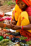 Woman selling bangles. Hindu woman selling traditional plastic  colourful bangles in a street market, Orchcha, Madhya Pradesh, India, taken 12.09.2010 Stock Images