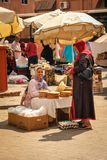 Bread seller in the souk. Marrakesh . Morocco. Woman selling bread in the souk. A street seller selling bread.  Marrakesh . Morocco Stock Images