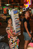 Woman selling CD in ho chi minh city at night Stock Image