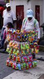 Woman selling chinese bubble toys in the street. Adult woman sell some toys to make bubbles and other water toys in the middle of the mexican independence day stock photos