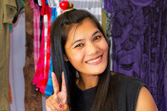 Woman selling clothes on the market in Thailand Stock Photos