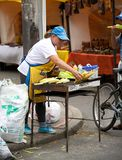 Woman selling corn at flea market Stock Images
