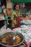 A Woman Selling Dried Fishes Royalty Free Stock Photography