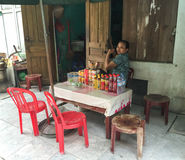 A woman selling drinks on street in Hanoi, Vietnam Royalty Free Stock Images