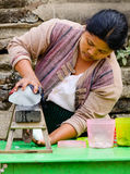 A woman selling drinks on street in Mandalay, Myanmar Stock Photos