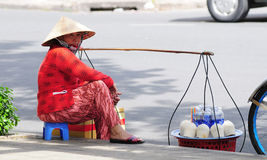 A woman selling drinks on street in Saigon, southern Vietnam Stock Photo