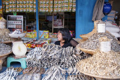 Woman selling dry fish is a stall Royalty Free Stock Photos