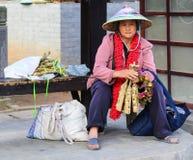 The woman selling eggs in hot sea park,tengchong,yunnan,china Royalty Free Stock Photography