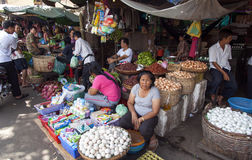 Woman Selling Eggs in Market. Locals sell their goods in a local market in Phnom Penh, Cambodia Royalty Free Stock Photo