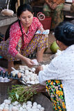 Woman selling eggs in traditional market Royalty Free Stock Photo