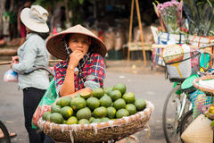 Woman selling exotic fruits in the streets royalty free stock images