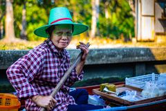 Woman selling Floating Market Thailand stock photography