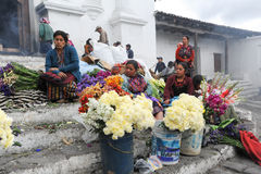 Woman selling flowers in front of church of Santo Tomas at Chich Royalty Free Stock Image