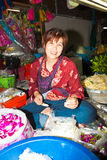 Woman selling flowers at Pak Khlong Thalat market Stock Photo