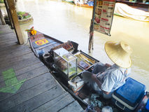 Woman selling food at Pattaya Floating Market royalty free stock photos