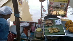 Woman selling food at Pattaya Floating Market. Thailand stock video footage