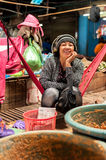 Woman selling food at traditional marketplace. Cambodia Stock Photo