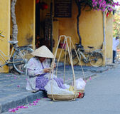 A woman selling foods on street in Hoian, Vietnam Royalty Free Stock Images