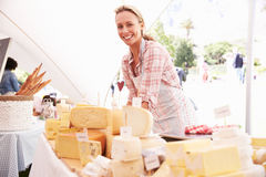 Woman Selling Fresh Cheese At Farmers Food Market Royalty Free Stock Photography