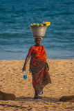 Woman selling fresh fruits on the beach Royalty Free Stock Images