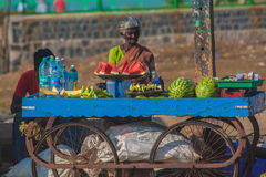 Woman selling fresh fruits on the beach Stock Photography