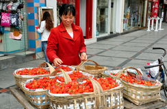 Pengzhou, China: Woman Selling Strawberries Stock Photography