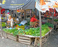 WOMAN SELLING FRESH VEGETABLES IN INDONESIA Stock Image