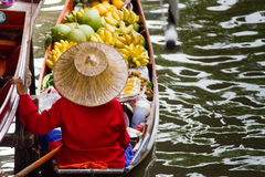 A woman selling fruits at floating market. Royalty Free Stock Photo