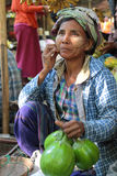 Woman selling fruits at the market Royalty Free Stock Photos