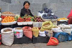 Woman is selling fruits and spicery on the market Stock Photography