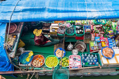 Woman selling goods from a boat in Vietnam Stock Photos