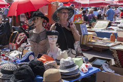 Woman selling hats Royalty Free Stock Photo