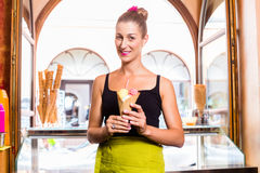 Woman selling ice cream cone Royalty Free Stock Photos