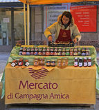 Woman is selling jam at the fair in Bergamo Royalty Free Stock Photography
