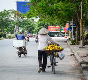 A woman selling local fruits on the street Stock Images
