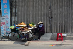 A woman selling local fruits on the street Royalty Free Stock Images