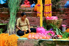 Woman Selling Marigolds Royalty Free Stock Image