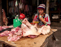 Woman selling meat at marketplace. Cambodia Stock Photos
