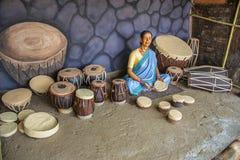 Woman selling musical instruments, sculpture museum, Kaneri Math, Kolhapur, Maharashtra Royalty Free Stock Photography