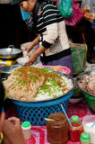 Woman selling noodles at marketplace. Cambodia Royalty Free Stock Photos