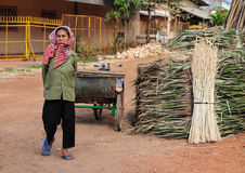 A woman selling palm leaves on street in Kampot, Cambodia Stock Photos