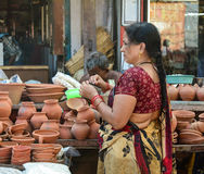 A woman selling pottery on street in Varanasi, India Stock Image