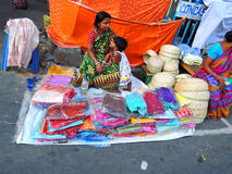 A woman selling sarees Stock Photos