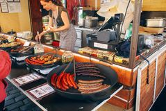 Prague Food and food markets. Woman selling smoked pork in a food market in Prague stock images