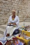 Woman selling souvenirs Stock Image