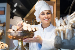 Woman selling tarts and sweet pastry Royalty Free Stock Image