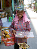 Woman selling Thai gifts, Thailand. Royalty Free Stock Images