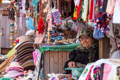 Woman Selling Trinkets in Assos Turkey. ASSOS, TURKEY – APRIL 23: Unidenified woman selling trinkets and souvenirs during buildup to Anzac Day on April 23 Stock Photography