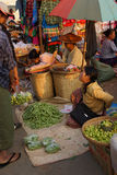 Woman selling vegetables Royalty Free Stock Images